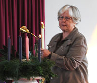 Barbara Wisdom lighting the Advent 2 candle