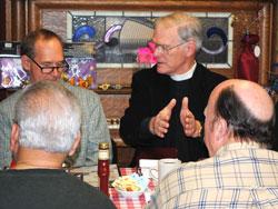 Rev. Christ Agnew makes a point to David Beck